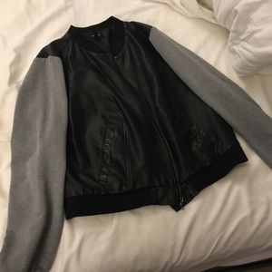 Faux leather  with grey sleeves.Torrid size 2